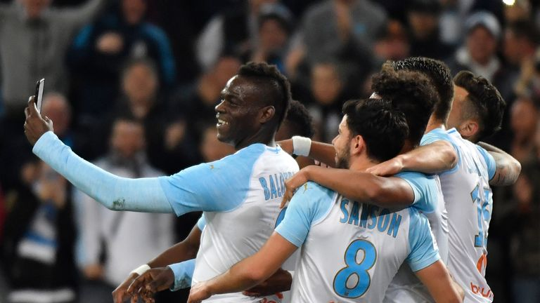 Balotelli celebrates a goal with team-mates