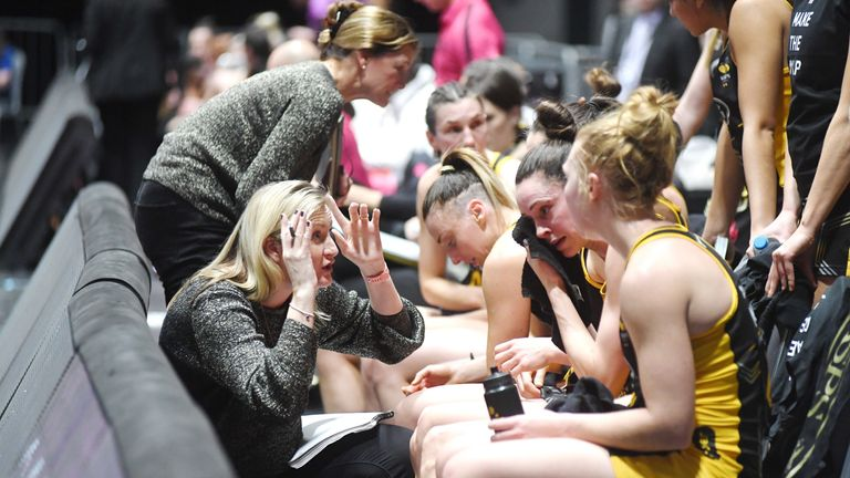 Mel Mansfield of Wasps Netball speaking to her players at quarter time.