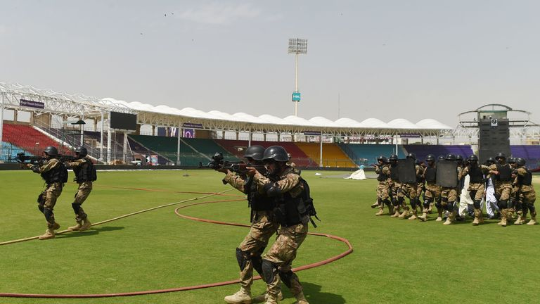 Pakistani soldiers take part in a drill exercise at Karachi's National Cricket Stadium