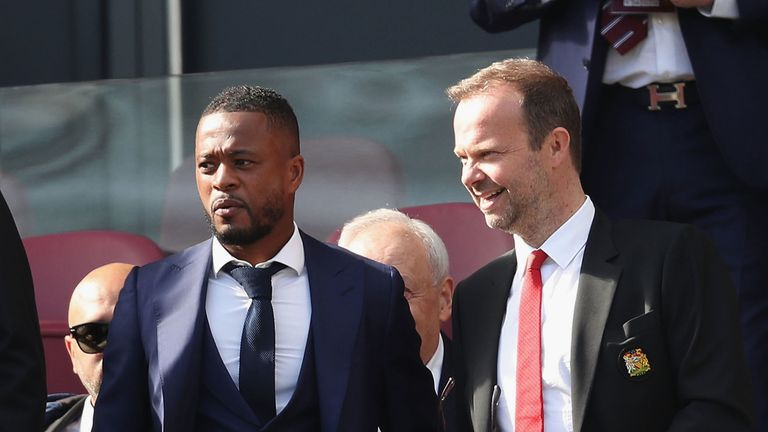 Evra in the directors' box at a United game alongside executive vice-chairman Ed Woodward