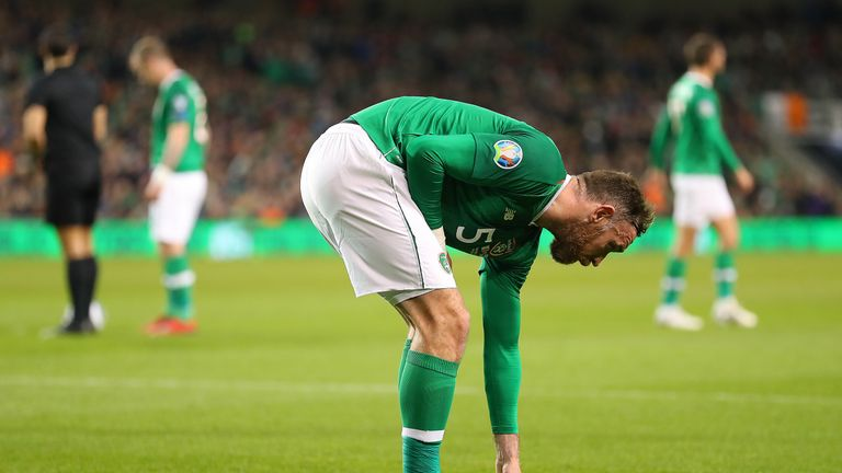 Republic of Ireland defender Richard Keogh removes balls which were thrown onto the pitch during Tuesday night's game