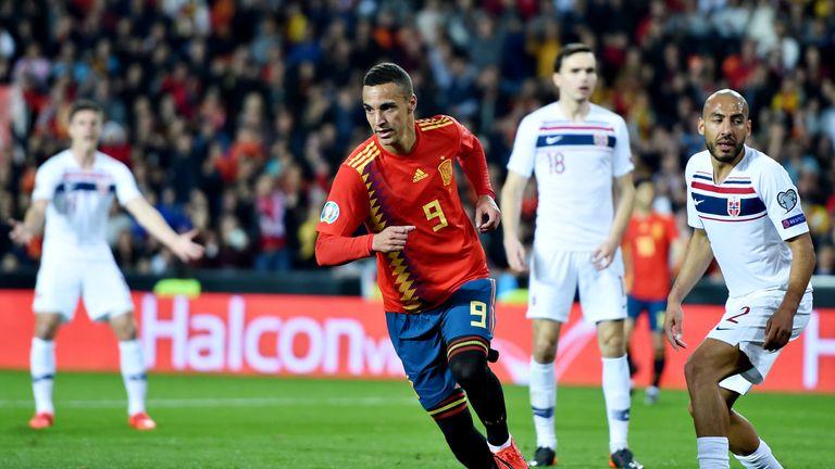 Striker Rodrigo wheels away after firing Spain ahead in the first half