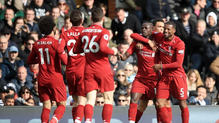 Sadio Mane celebrates with Liverpool team-mates after scoring the opener against Fulham