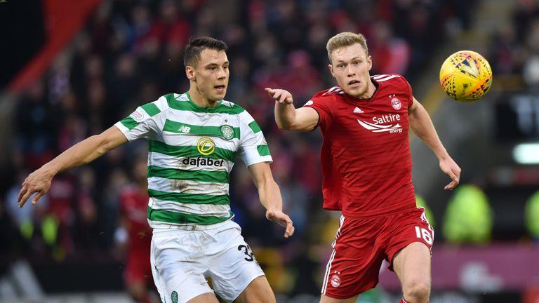 Cosgrove in action with Celtic's Filip Benkovic