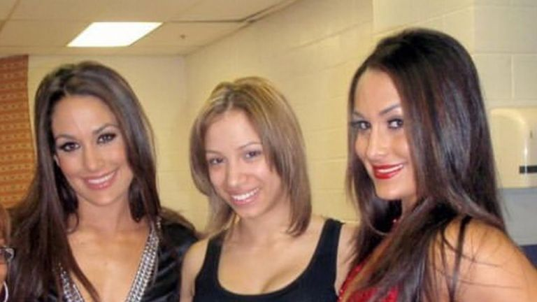 Long before she was The Boss, Sasha Banks was having her picture taken with the Bella Twins