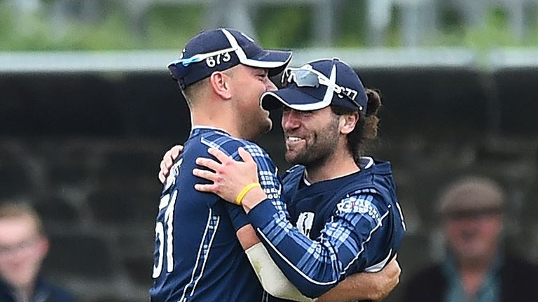 Scotland's Dylan Budge and Mark Watt celebrate in the second T20 against Pakistan last summer