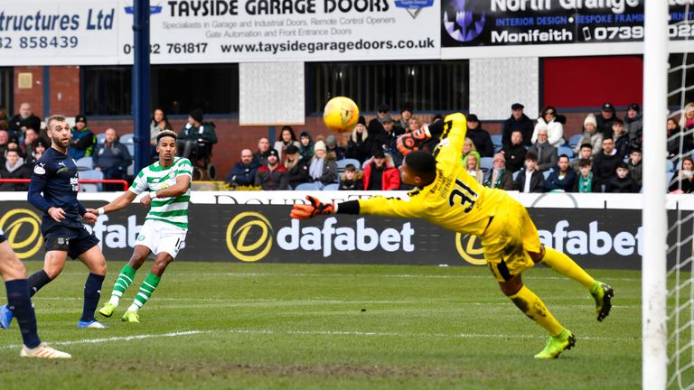 Sinclair sees his shot saved by Dundee goalkeeper Seny Dieng in the first half