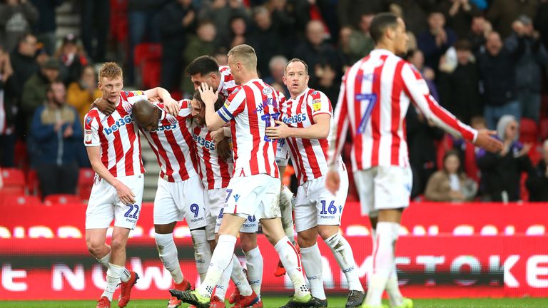 Stoke City's Benik Afobe (second left) celebrates scoring his side's second goal of the game with team mates