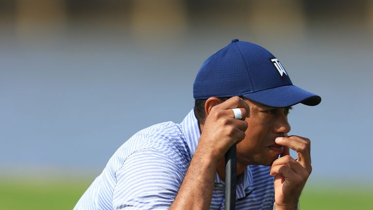 Tiger Woods needed three attempts to find dry land at the 17th