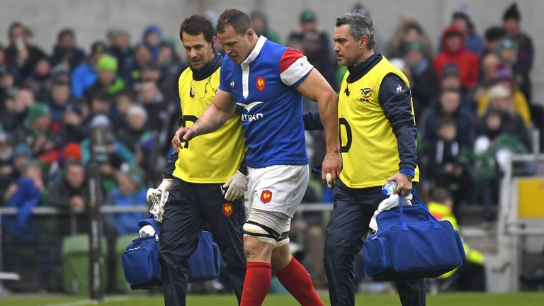Wenceslas Lauret (C) is helped from the pitch at the Aviva Stadium after picking up an injury