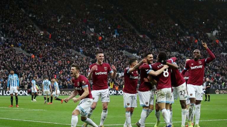 West Ham's players celebrate the dramatic late turnaround
