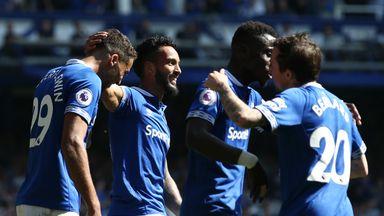 Theo Walcott celebrates scoring for Everton against Man Utd