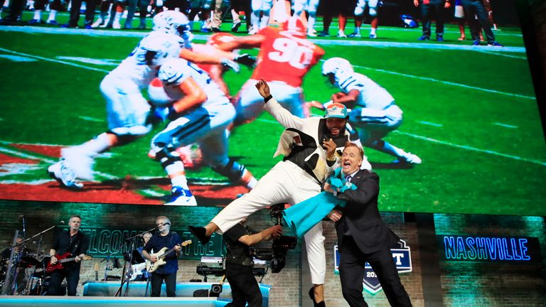 Christian Wilkins celebrated his draft pick by nearly taking out NFL Commissioner Roger Goodell!