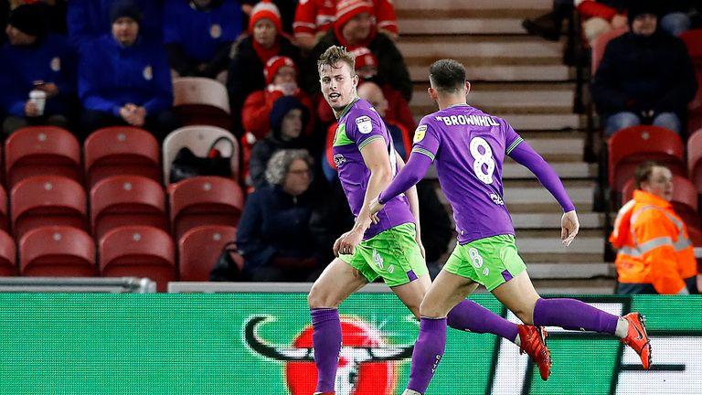 Bristol City's Adam Webster (left) celebrates scoring his team's goal against Middlesbrough