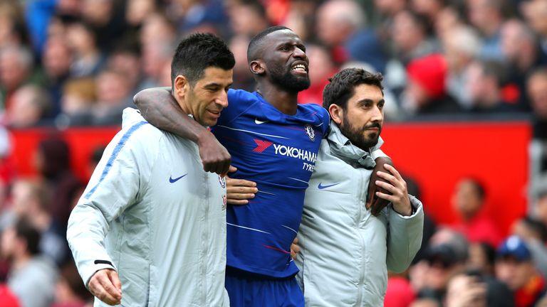 Chelsea defender Antonio Rudiger is helped off