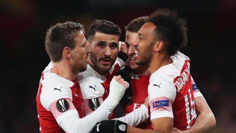 Aaron Ramsey celebrates scoring with his Arsenal team-mates