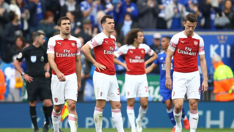 Arsenal players look dejected during their 3-0 defeat to Leicester