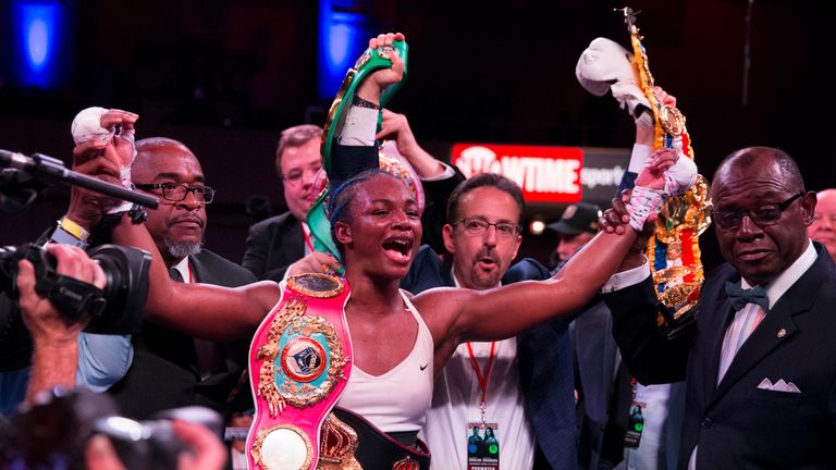 Claressa Shields celebrates with all four world middleweight titles