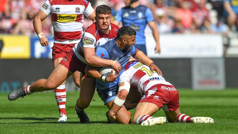 St Helens' Dominique Peyroux is tackled by ' Romain Navarette and Oliver Partington