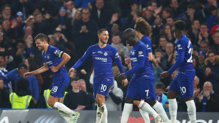 Hazard celebrates with team-mates after scoring his superb solo goal