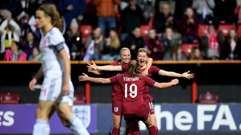 Ellen White celebrates scoring England's second goal against Spain with Toni Duggan and Georgia Stanway