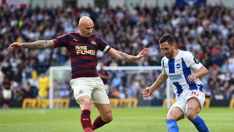 Florin Andone takes on Jonjo Shelvey at the AMEX Stadium
