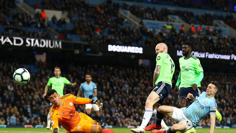 Phil Foden sees his shot saved by Neil Etheridge