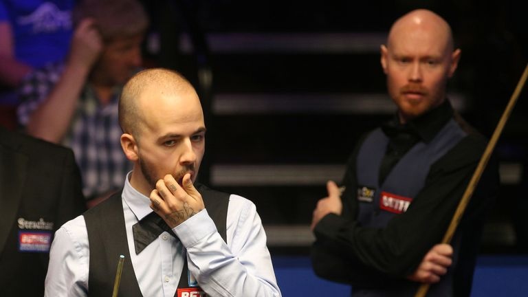 Gary Wilson (right) won a 79-minute long final frame against Luca Brecel on Sunday