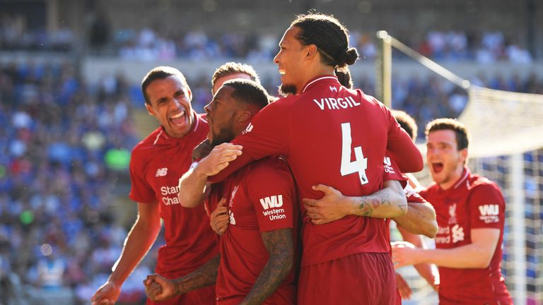 Georginio Wijnaldum celebrates scoring against Cardiff