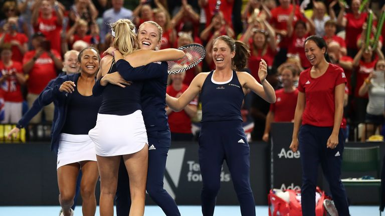 Katie Boulter's GB teammates ran onto the court to celebrate with her