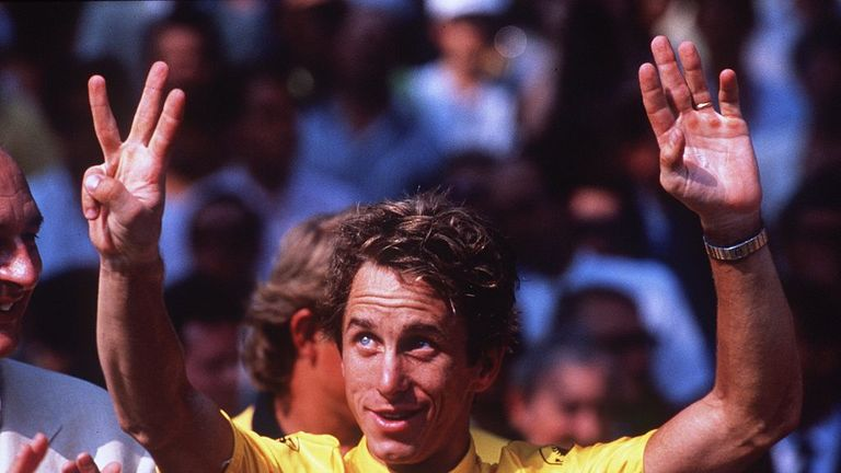 Greg LeMond celebrates after winning the Tour de France in 1990