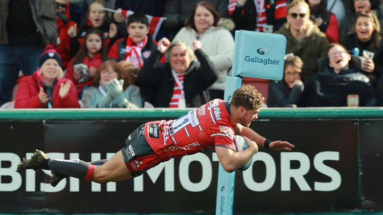 Henry Purdy of Gloucester dives in for a try