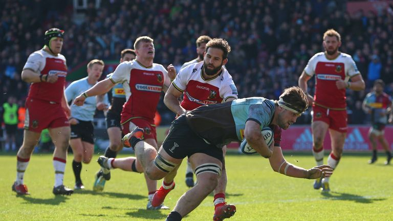 Jack Clifford of Harlequins breaks away to score a try