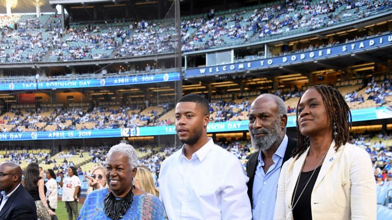 The Robinson family pose for a photo before the game between the Cincinnati Reds and the Los Angeles Dodgers
