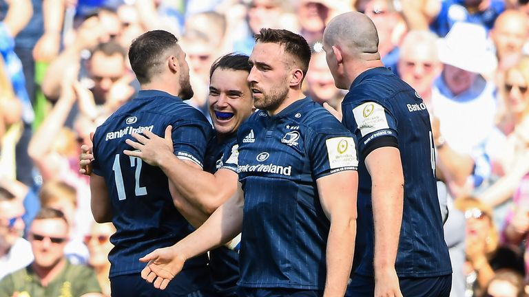 James Lowe celebrates with team-mates after scoring Leinster's first try