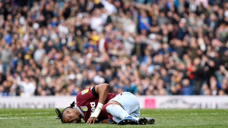 Jonathan Kodjia lay on the ground injured as Leeds controversially played on