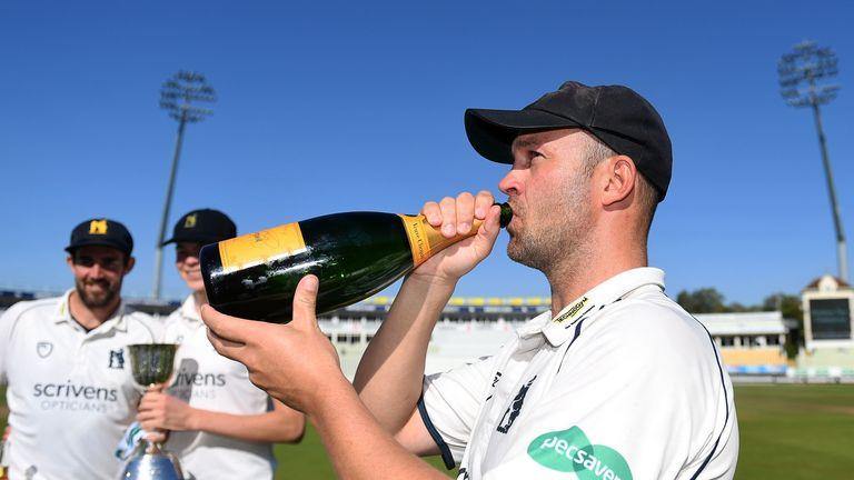 Trott celebrates Warwickshire winning the Division Two title against Kent at Edgbaston last September