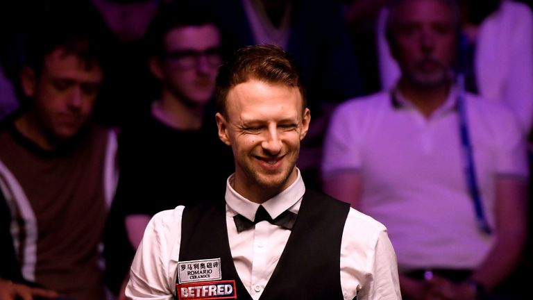 Judd Trump came through a final-frame decider to advance in Sheffield