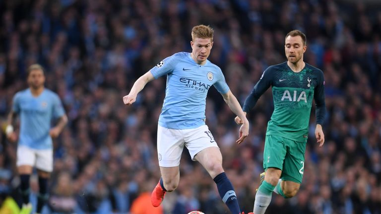Kevin De Bruyne drives away from Christian Eriksen during a frantic first half