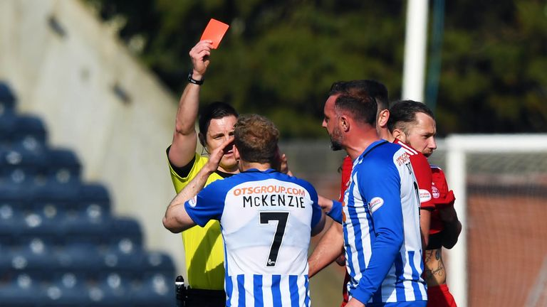 Referee Steven McLean brandishes his third red card of the afternoon to Kilmarnock's Rory McKenzie