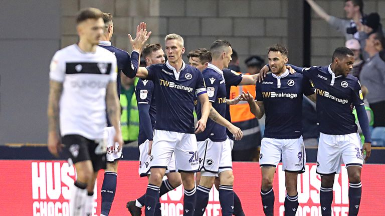 Lee Gregory is congratulated by his team-mates after putting Millwall ahead