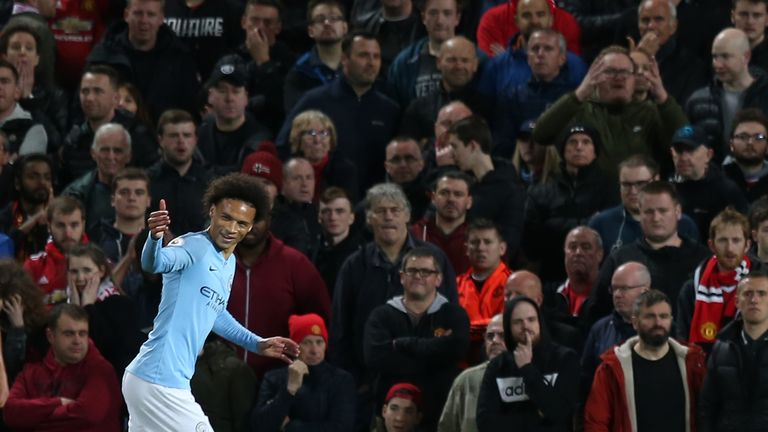 Leroy Sane gestures to his team-mates after doubling Manchester City's lead