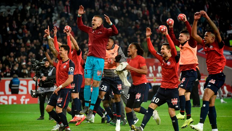 Lille players celebrate their 5-1 win against PSG