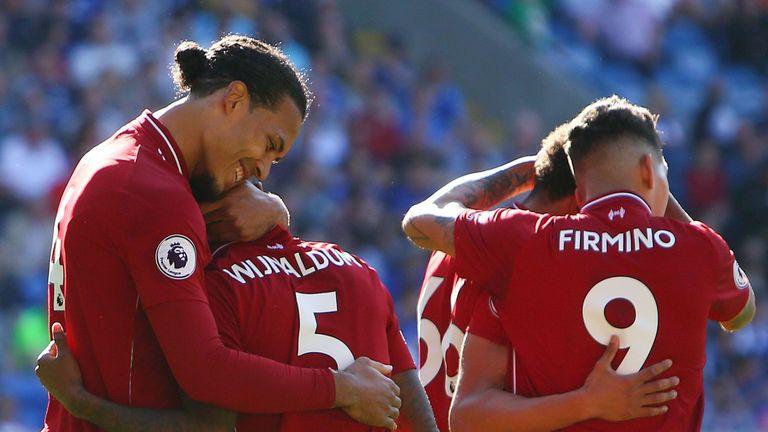 Virgil van Dijk congratulates Georginio Wijnaldum after his opener against Cardiff