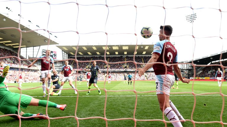 Matt Lowton's control took the ball barely 3cm over the line from Sergio Aguero's shot