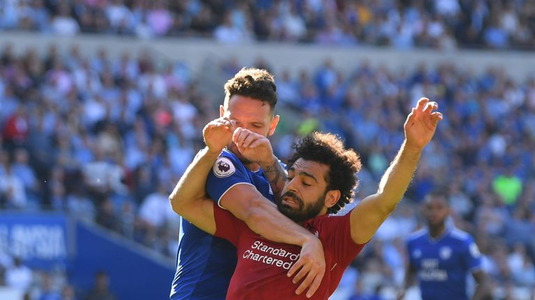 Mohamed Salah wins a penalty after a challenge from Sean Morrison