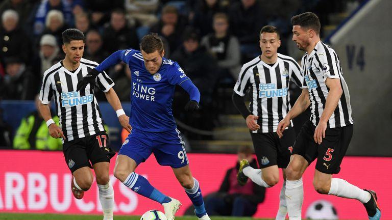 Jamie Vardy battles for possession