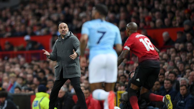 Pep Guardiola urges his team on at Old Trafford