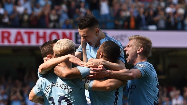 Phil Foden celebrates with team-mates after putting Man City ahead