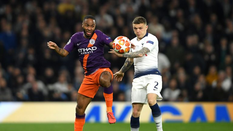 Raheem Sterling battles for the ball with Kieran Trippier